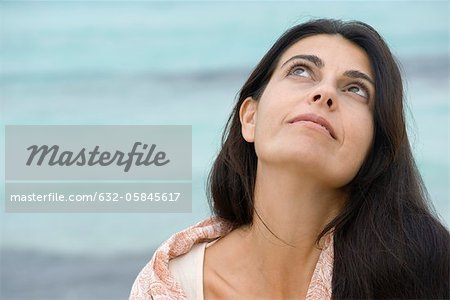 Woman at the beach, looking up Stock Photo - Premium Royalty-Free, Image code: 632-05845617