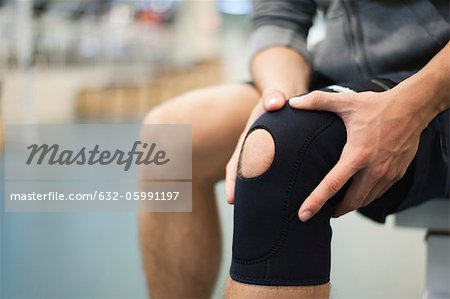 Man wearing knee brace, cropped Stock Photo - Premium Royalty-Free, Image code: 632-05991197