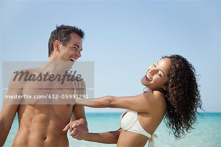 Couple having fun together at the beach Stock Photo - Premium Royalty-Free, Image code: 632-05991291