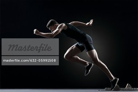 Runner leaving starting block Stock Photo - Premium Royalty-Free, Image code: 632-05991508