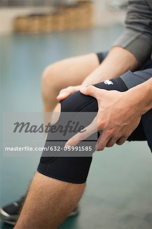 Man wearing knee brace, cropped Stock Photo - Premium Royalty-Free, Image code: 632-05991585