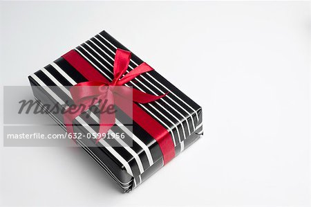 Festively wrapped gift Stock Photo - Premium Royalty-Free, Image code: 632-05991956