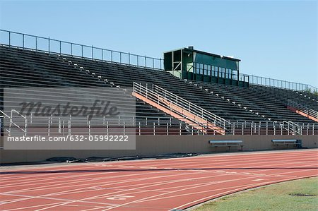 Empty stadium and running track Stock Photo - Premium Royalty-Free, Image code: 632-05992222