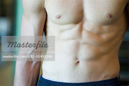 Muscular barechested man, mid section Stock Photo - Premium Royalty-Free, Image code: 632-05992296