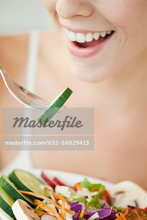 Woman eating salad, cropped Stock Photo - Premium Royalty-Free, Image code: 632-06029413