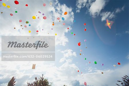 Balloons floating toward sky Stock Photo - Premium Royalty-Free, Image code: 632-06029524