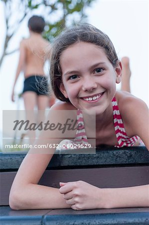 Girl in bikini lying on stomach, portrait Stock Photo - Premium Royalty-Free, Image code: 632-06029529