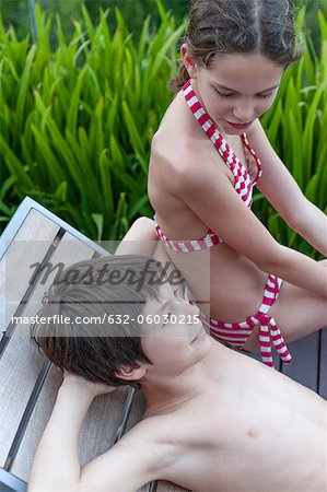 Brother and sister relaxing on deckchair Stock Photo - Premium Royalty-Free, Image code: 632-06030215