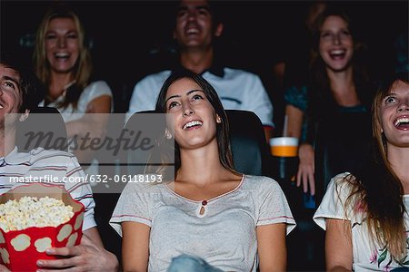 Audience laughing in movie theater Stock Photo - Premium Royalty-Free, Image code: 632-06118193