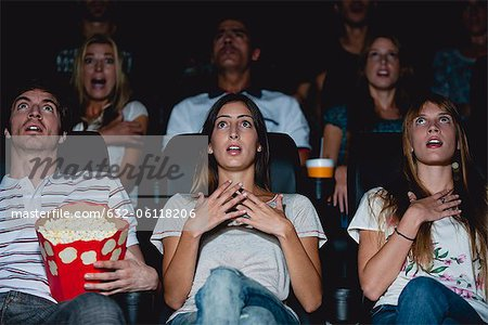 Audience in movie theater with shocked expressions Stock Photo - Premium Royalty-Free, Image code: 632-06118206