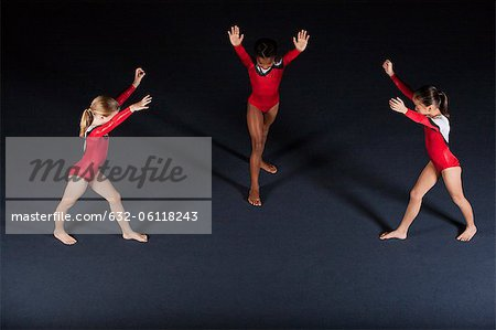 Young girl gymnasts preparing to perform handstands Stock Photo - Premium Royalty-Free, Image code: 632-06118243
