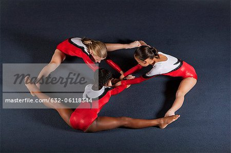Young girl gymnasts performing floor routine Stock Photo - Premium Royalty-Free, Image code: 632-06118344