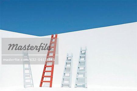 Ladders leaning against wall Stock Photo - Premium Royalty-Free, Image code: 632-06118345
