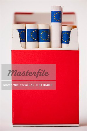Cigarette pack containing rolled euros Stock Photo - Premium Royalty-Free, Image code: 632-06118408