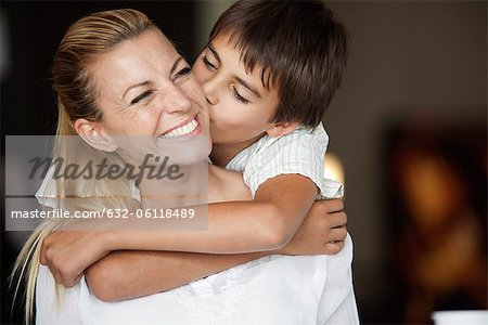 Boy kissing mother's cheek Stock Photo - Premium Royalty-Free, Image code: 632-06118489