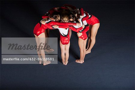 Team of gymnasts huddling Stock Photo - Premium Royalty-Free, Image code: 632-06118501
