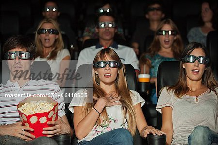 Audience wearing 3-D glasses in movie theater Stock Photo - Premium Royalty-Free, Image code: 632-06118503