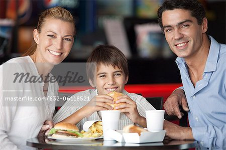 Family eating together in fast food restaurant, portrait Stock Photo - Premium Royalty-Free, Image code: 632-06118521