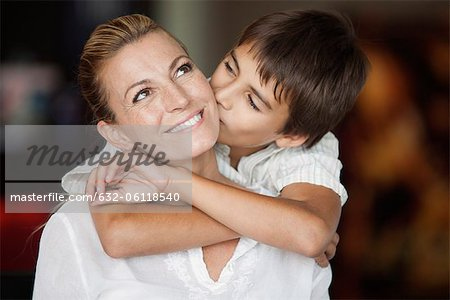 Boy kissing his mother's cheek Stock Photo - Premium Royalty-Free, Image code: 632-06118540