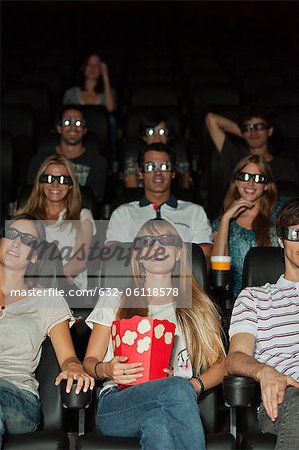 Audience wearing 3-D glasses in movie theater Stock Photo - Premium Royalty-Free, Image code: 632-06118578