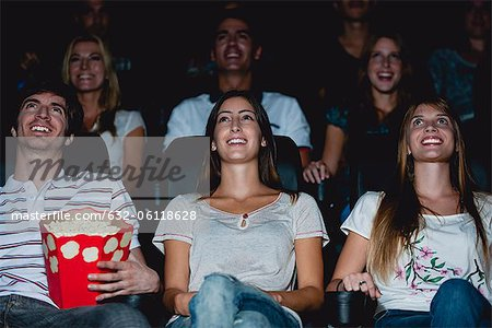 Audience watching movie in theater Stock Photo - Premium Royalty-Free, Image code: 632-06118628