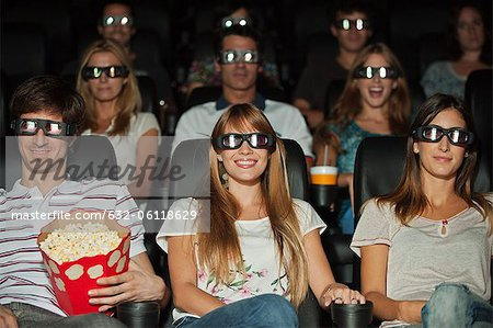 Audience wearing 3-D glasses in movie theater Stock Photo - Premium Royalty-Free, Image code: 632-06118629