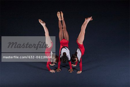 Young female gymnasts performing handstands Stock Photo - Premium Royalty-Free, Image code: 632-06118664