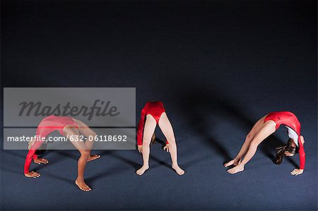 Young girl gymnasts performing backbends Stock Photo - Premium Royalty-Free, Image code: 632-06118692