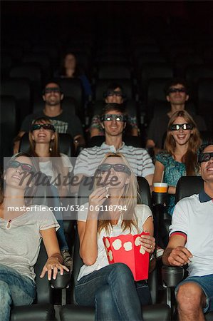 Audience wearing 3-D glasses in movie theater Stock Photo - Premium Royalty-Free, Image code: 632-06118794