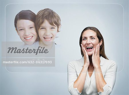 Woman doing video conference with children using advanced touch screen technology Stock Photo - Premium Royalty-Free, Image code: 632-06317093