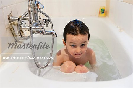 Boy taking a bath Stock Photo - Premium Royalty-Free, Image code: 632-06317229