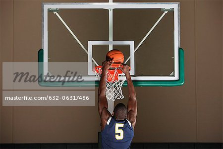 Basketball player making a basket Stock Photo - Premium Royalty-Free, Image code: 632-06317486