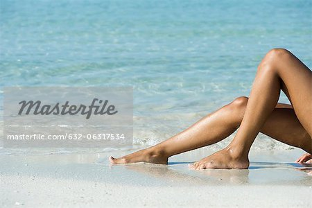 Woman's legs on beach, low section Stock Photo - Premium Royalty-Free, Image code: 632-06317534