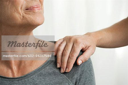 Comforting hand on senior woman's shoulder, cropped Stock Photo - Premium Royalty-Free, Image code: 632-06317584