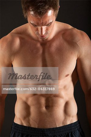 Barechested muscular man Stock Photo - Premium Royalty-Free, Image code: 632-06317869