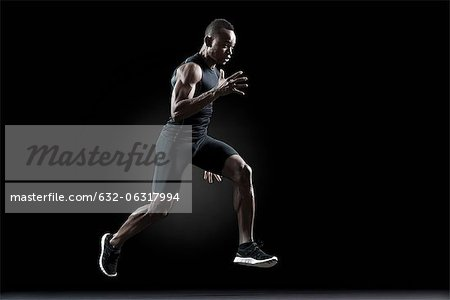 Runner running Stock Photo - Premium Royalty-Free, Image code: 632-06317994