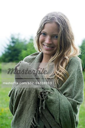 Young woman wrapped in blanket, portrait Stock Photo - Premium Royalty-Free, Image code: 632-06318003