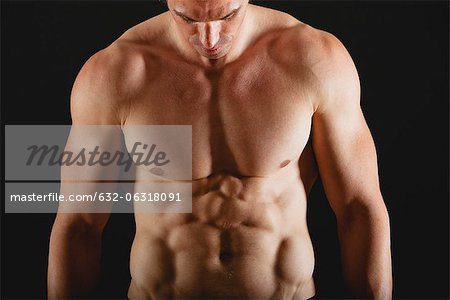 Barechested muscular man Stock Photo - Premium Royalty-Free, Image code: 632-06318091