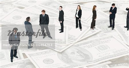 Executives lined up on image of one-hundred dollar bills Stock Photo - Premium Royalty-Free, Image code: 632-06404703