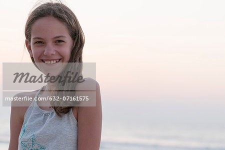 Preteen girl at beach, portrait Stock Photo - Premium Royalty-Free, Image code: 632-07161575