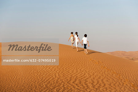 Children walking in desert, rear view Stock Photo - Premium Royalty-Free, Image code: 632-07495019