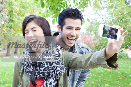 Couple taking self portrait with smartphone Stock Photo - Premium Royalty-Free, Image code: 632-07674444