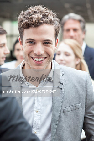 Young business associate with colleagues Stock Photo - Premium Royalty-Free, Image code: 632-07674587