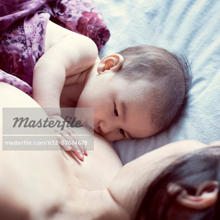 Mother breastfeeding baby Stock Photo - Premium Royalty-Free, Image code: 632-07674678