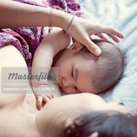 Mother breastfeeding baby Stock Photo - Premium Royalty-Free, Image code: 632-07674679