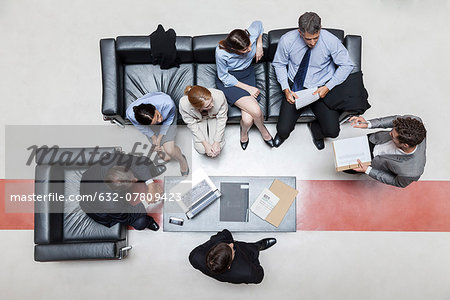 Executives in meeting, overhead view Stock Photo - Premium Royalty-Free, Image code: 632-07809423