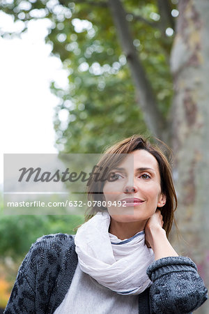 Woman relaxing outdoors, portrait Stock Photo - Premium Royalty-Free, Image code: 632-07809492