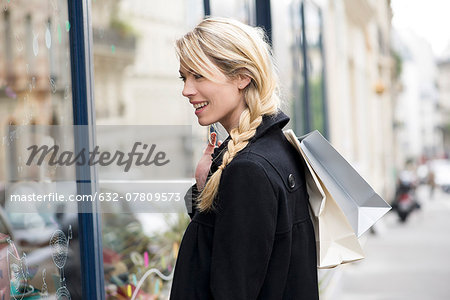Woman window shopping Stock Photo - Premium Royalty-Free, Image code: 632-07809573