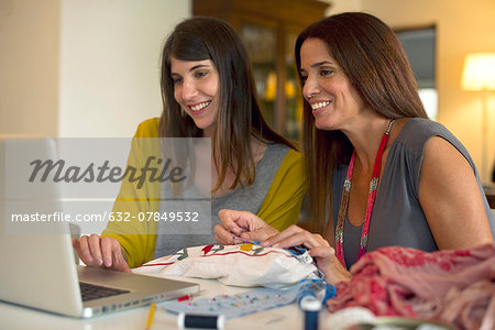 Sisters learning embroidery together by watching online videos Stock Photo - Premium Royalty-Free, Image code: 632-07849532