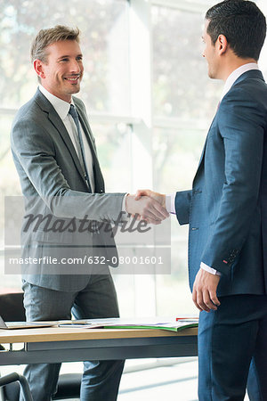 Businessmen shaking hands in office Stock Photo - Premium Royalty-Free, Image code: 632-08001601